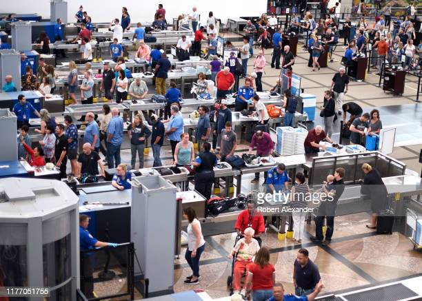 Lines of airplane passengers proceed through the TSA security checkpoint at Denver International Airport in Denver, Colorado.