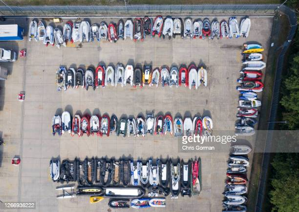 Lines of boats believed to have been used by migrants to cross the English Channel are stored at a lorry storage depot on August 12,2020 in Dover,...