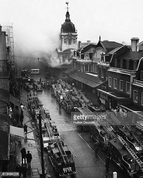 Lines of fire engines outside Smithfield meat market in London as firefighters tackle the blaze which lasted several hours