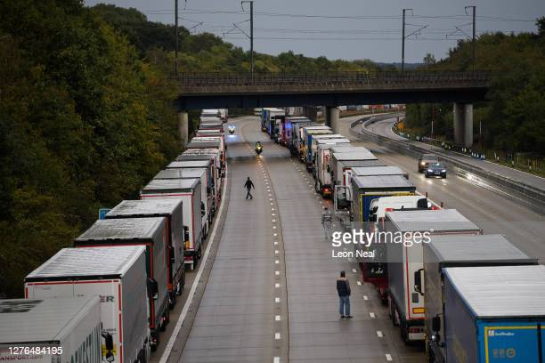 Lines of heavy goods vehicles and cargo lorries are seen queued along the M20 motorway as part of the Operation Stack traffic control plan, on...