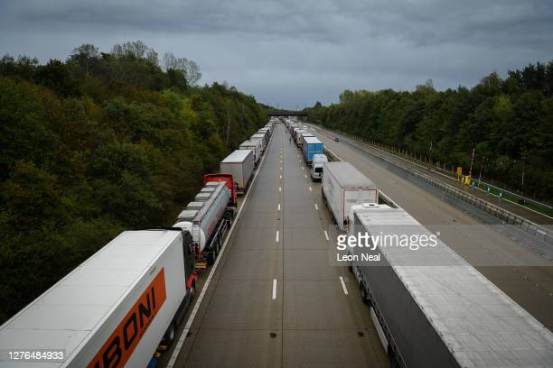 Lines of heavy goods vehicles and cargo lorries are seen queued along the M20 motorway as part of the Operation Stack traffic control plan on...