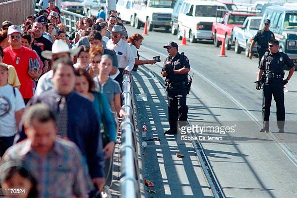Lines of people wait to cross the Paso del Norte International Bridge October 19 2001 from Juarez Mexico to El Paso Texas Pedestrians at border...