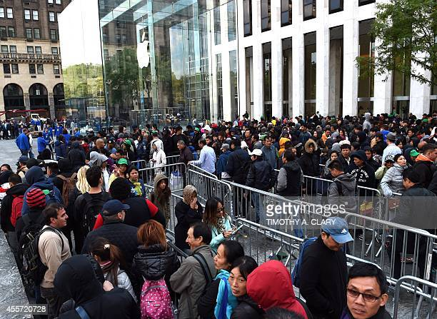 Lines of people wait to get in the Apple store on Fifth Avenue on September 19 2014 in New York City to purchase the new iPhone 6 The California tech...