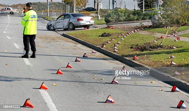 MURDER 2 / 10/30/05 Lines of police markers show the path taken by out of control car as Detective Constable Tim Kuttschrutter a forensic officer...