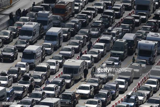 Lines of traffic queue to enter the port of Dover on the south coast of England on July 24 2016 British officials were drafted in to help French...