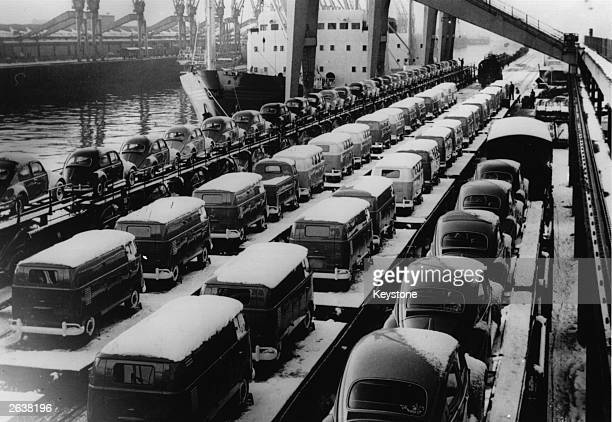 Lines of Volkswagen cars and vans ready for export on the transporter 'Fidelio' at Bremen Harbour Germany bound for the USA