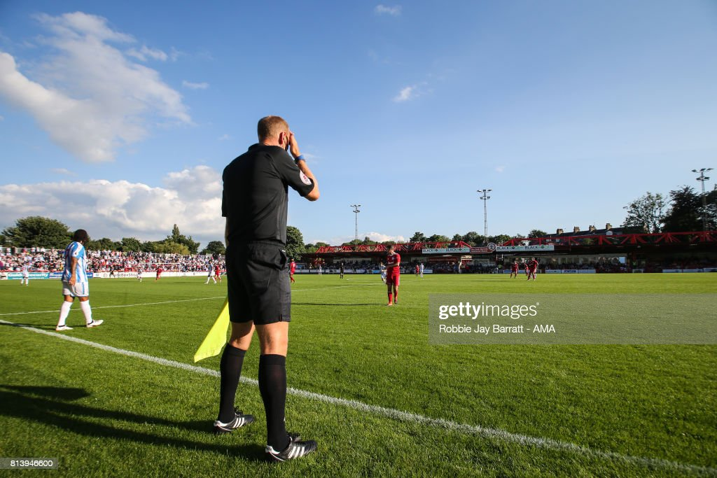 A linesman at Wham Stadium, home stadium of Accrington Stanley during the pre-season friendly match between Accrington Stanley and Huddersfield Town at Wham Stadium on July 12, 2017 in Accrington, England.