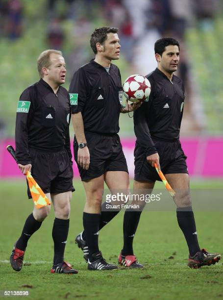 Linesman Bernd Hauer Referee Michael Weiner and linesman Babak Rafati during The Bundesliga match between FC Bayern Munich and 04 Bayer Leverkusen at...