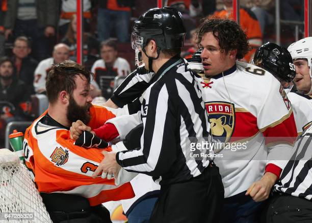 Linesman Bevan Mills breaks up a scrum between Radko Gudas of the Philadelphia Flyers and Alex Petrovic of the Florida Panthers on March 2 2017 at...