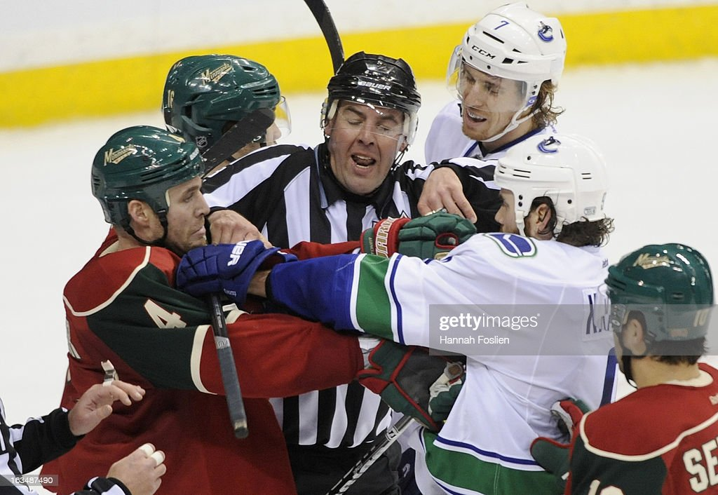 Linesman Brian Mach #78 gets between Clayton Stoner #4 of the Minnesota Wild and Zack Kassian #9 of the Vancouver Canucks during the third period of the game on March 10, 2013 at Xcel Energy Center in St Paul, Minnesota. The Wild defeated the Canucks 4-2.