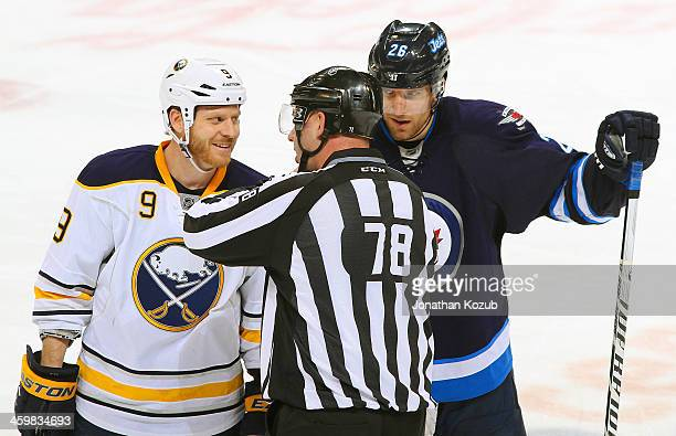 Linesman Brian Mach gives an explanation on a secondperiod call to Steve Ott of the Buffalo Sabres and Blake Wheeler of the Winnipeg Jets at the MTS...