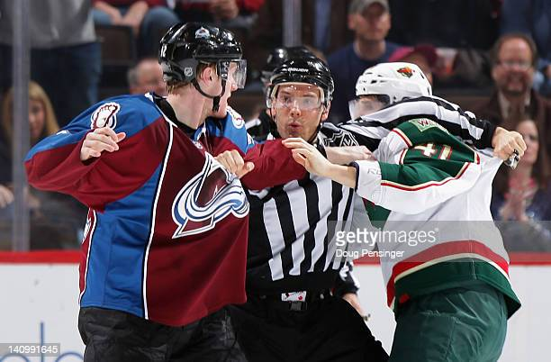 Linesman Bryan Pancich tries to preempt a fight between Gabriel Landeskog of the Colorado Avalanche and Jed Ortmeyer of the Minnesota Wild in the...