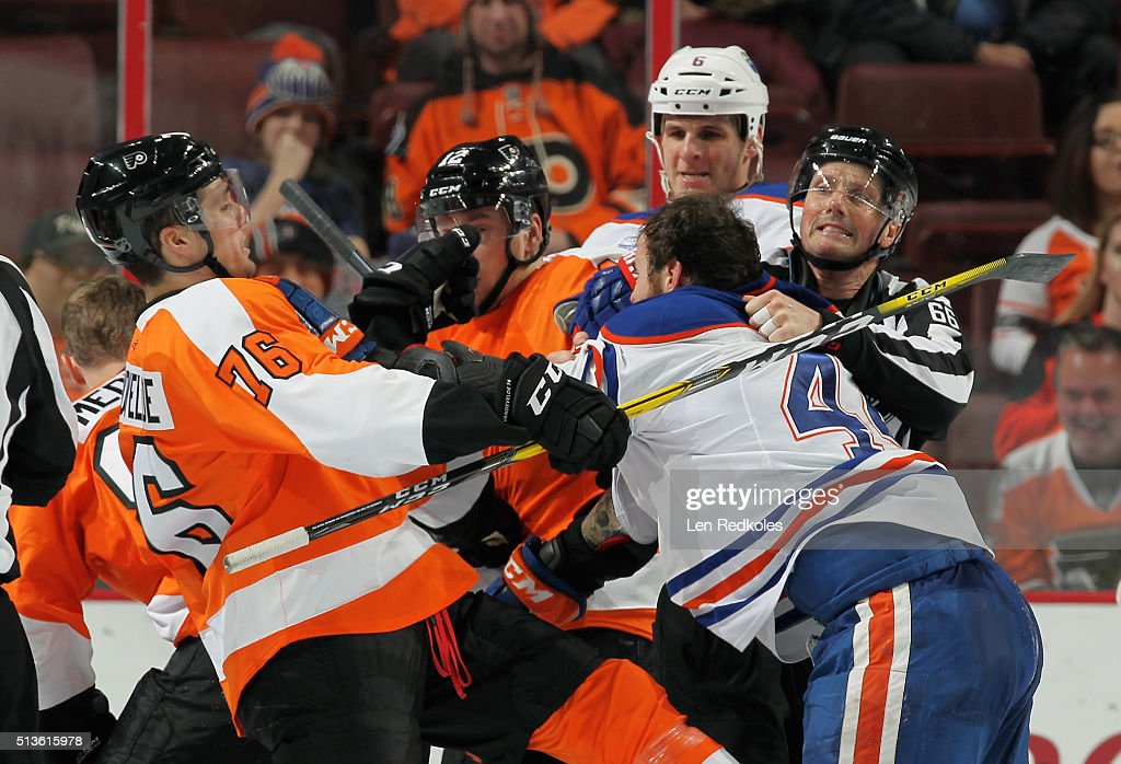 Linesman Darren Gibbs #66 breaks up a scuffle between Chris VandeVelde #76 of the Philadelphia Flyers and Zack Kassian #44 of the Edmonton Oilers on March 3, 2016 at the Wells Fargo Center in Philadelphia, Pennsylvania. The Oilers went on to defeat the Flyers 4-0.