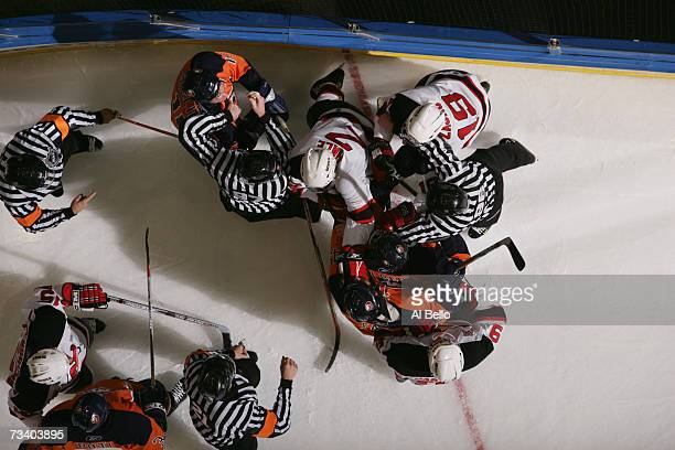 Linesman David Brisebois and Jean Morin seperate Mike Sillinger Drew Fata and Andy Hilbert of the New York Islanders from David Hale Zach Parise and...