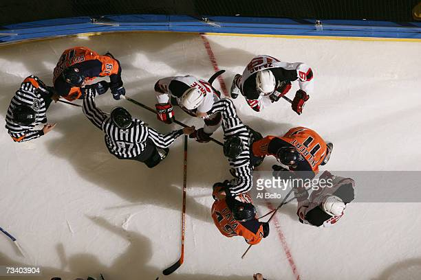 Linesman David Brisebois and Jean Morin seperate Mike Sillinger Drew Fata and Andy Hilbert of the New York Islanders from David Hale and Travis Zajac...