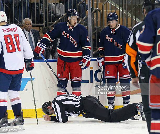 Linesman Derek Amell is injured during the game between the Washington Capitals and the New York Rangers at Madison Square Garden on January 9 2016...
