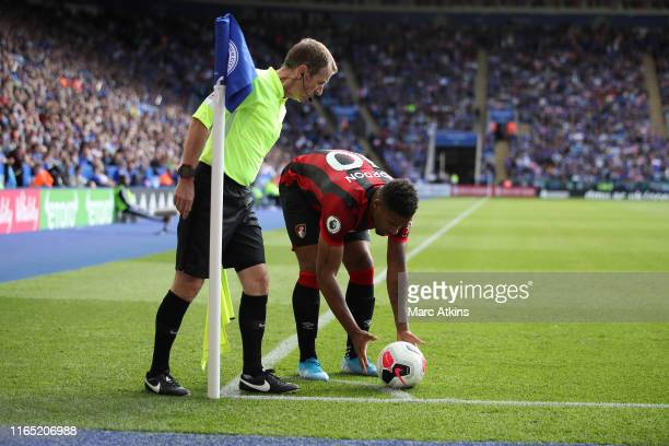 Linesman Derek Eaton looks on as Jordon Ibe of AFC Bournemouth places the ball prior to taking a corner during the Premier League match between...