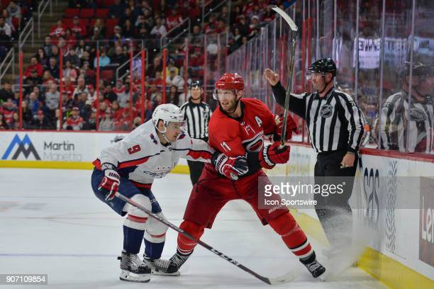 NHL linesman Derek Nansen whistles the play offsides in front of Carolina Hurricanes Center Jordan Staal and Washington Capitals Defenceman Dmitry...