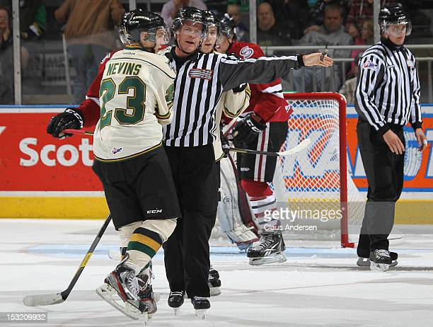 Linesman Drew Jackson tells Jack Nevins of the London Knights to head for the bench against the Guelph Storm in an OHL game on September 30 2012 at...