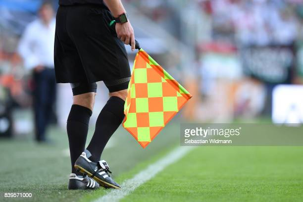 Linesman flag during the Bundesliga match between FC Augsburg and Borussia Moenchengladbach at WWK-Arena on August 26, 2017 in Augsburg, Germany.