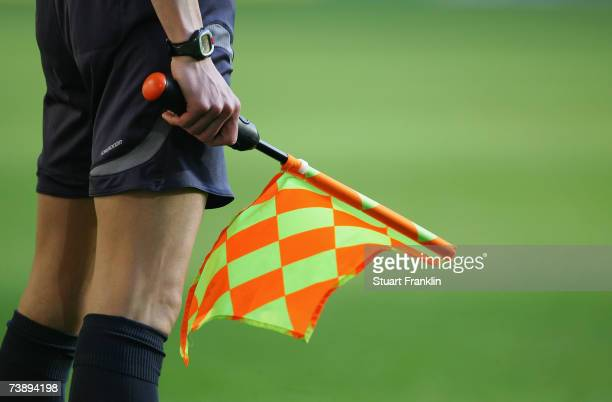 A linesman holds his flag during the Bundesliga match between Borussia Dortmund and Werder Bremen at the Signal Iduna Park on April 15 2007 in...