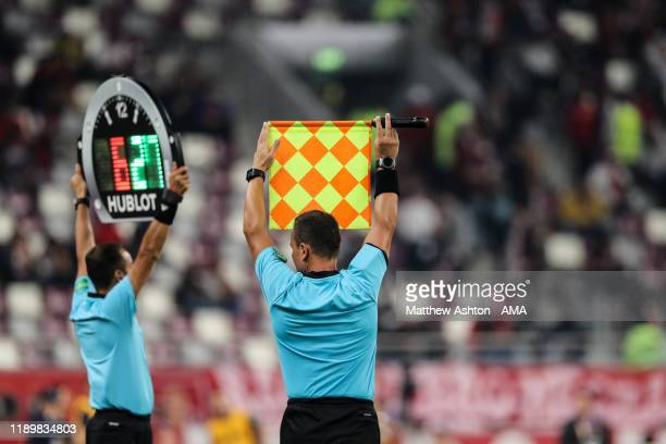 A linesman holds up his flag for a substitution during the FIFA Club World Cup Qatar 2019 Third Place Play Off match between Monterrey and Al Halil...
