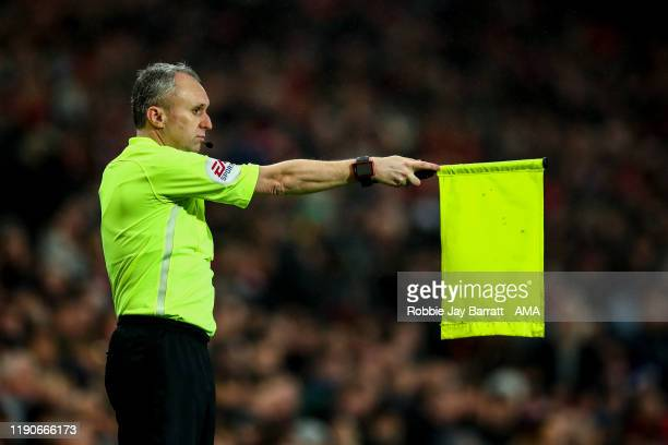 A linesman holds up his flag for an offside during the Premier League match between Manchester United and Newcastle United at Old Trafford on...