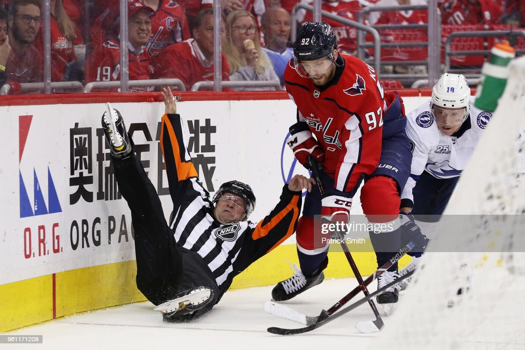 A linesman is upended as Evgeny Kuznetsov #92 of the Washington Capitals and Ondrej Palat #18 of the Tampa Bay Lightning vie for posession in the second period of Game Six of the Eastern Conference Finals during the 2018 NHL Stanley Cup Playoffs at Capital One Arena on May 21, 2018 in Washington, DC.