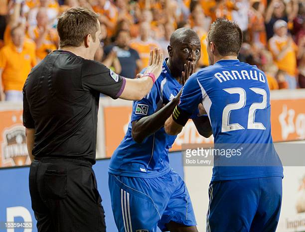 Linesman Jason Callum has words with Hassoun Camara and Davy Arnaud of the Montreal Impact after Brian Ching of the Houston Dynamo apparently scored...