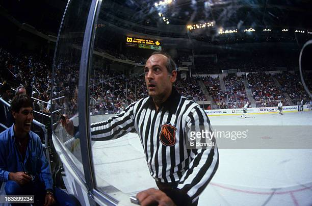Linesman John D'Amico looks at the crowd during an NHL game with the Hartford Whalers circa 1986 at the Hartford Civic Center in Hartford Connecticut