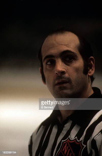 Linesman John D'Amico looks on during an NHL game circa 1975