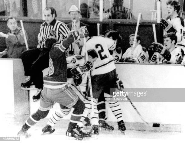Linesman John D'Amico sits on top of the boards as head coach George 'Punch' Imlach of the Buffalo Sabres has a few words for him as Walt Tkaczuk of...