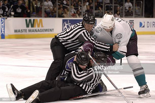 Linesman Jonny Murray and Pat Dapuzzo try to separate Todd Fedoruk of the Anaheim Mighty Ducks and Jeff Cowan of the Los Angeles Kings during the...