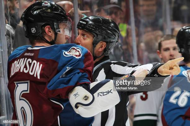 Linesman Jonny Murray holds back Erik Johnson of the Colorado Avalanche during Game One of the First Round of the 2014 Stanley Cup Playoffs against...