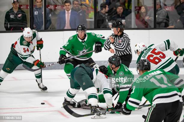 Linesman Kendall Hanley gets out of the way after dropping the puck during Day1 of the NHL Prospects Tournament game between the Dallas Stars and the...