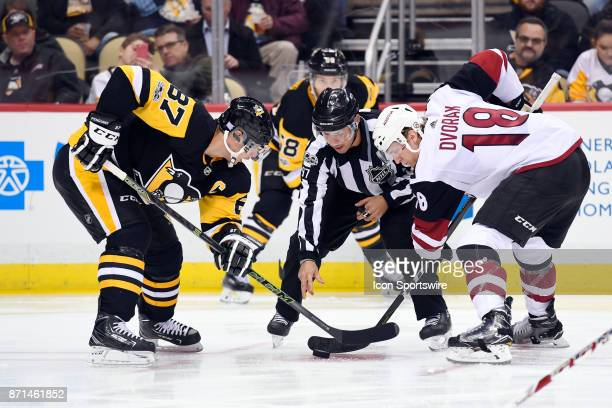 NHL linesman Kory Nagy drops the puck for a faceoff between Pittsburgh Penguins Center Sidney Crosby and Arizona Coyotes Center Christian Dvorak...