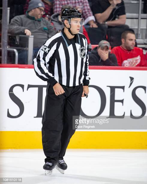Linesman Kory Nagy follows the play during an NHL game between the Detroit Red Wings and the Los Angeles Kings at Little Caesars Arena on December 10...