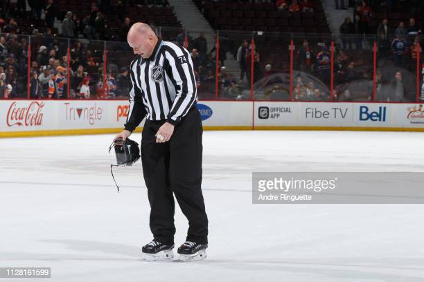 Linesman Lonnie Cameron who had announced he will be retiring at the end of the season leaves the ice after a game between the Ottawa Senators and...