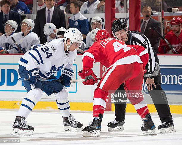 Linesman Mark Shewchyk drops the puck between Auston Matthews of the Toronto Maple Leafs and Luke Glendening of the Detroit Red Wings during an NHL...