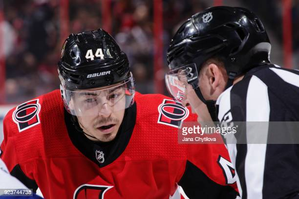 Linesman Mark Shewchyk prepares to drop the puck as JeanGabriel Pageau of the Ottawa Senators prepares for a faceoff against the Tampa Bay Lightning...