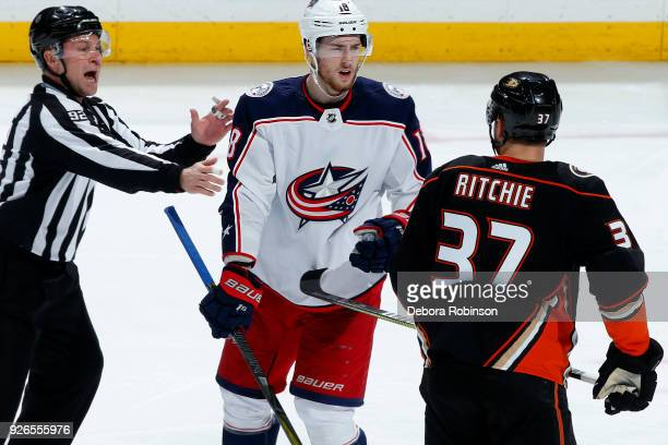 Linesman Mark Shewchyk separates PierreLuc Dubois of the Columbus Blue Jackets and Nick Ritchie of the Anaheim Ducks following a play on March 2 2018...