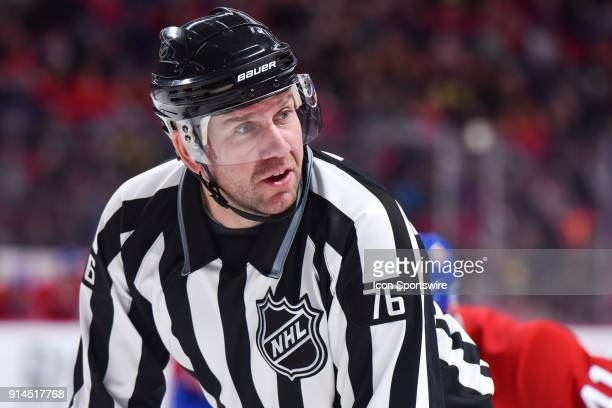 NHL linesman Michel Cormier discusses with a player behind him during the Anaheim Ducks versus the Montreal Canadiens game on February 3 at Bell...