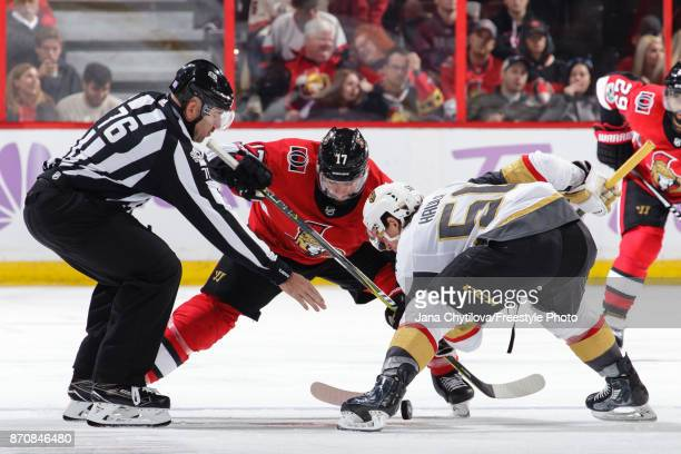 Linesman Michel Cormier drops the puck during a faceoff between Nate Thompson of the Ottawa Senators and Erik Haula of the Vegas Golden Knights at...