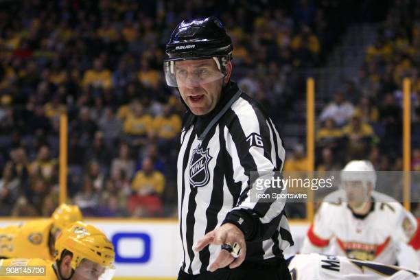 Linesman Michel Cormier is shown during the NHL game between the Nashville Predators and the Florida Panthers held on January 20 at Bridgestone Arena...