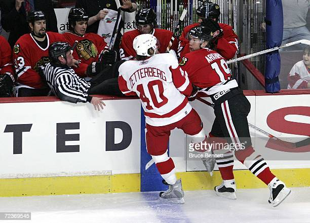 Linesman Pat Dapuzzo ends up in the bench as the result of a hit by Denis Arkhipov of the Chicago Black Hawks on Henrik Zetternerg of the Detroit Red...