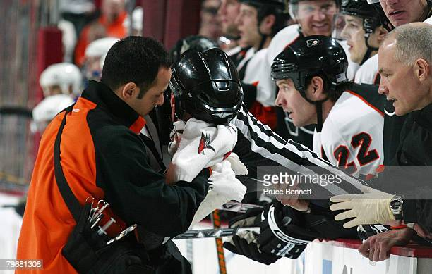 Linesman Pat Dapuzzo is injured by the skate of Steve Downie of the Philadelphia Flyers in the game against the New York Rangers on February 9 2008...