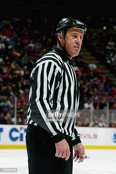 Linesman Pat Dapuzzo looks on during the New Jersey Devils game against the Pittsburgh Penguins at Continental Airlines Arena on February 16 2007 in...