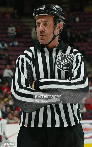 Linesman Pat Dapuzzo looks on during the NHL game between the New Jersey Devils and the Carolina Hurricanes at the Continental Airlines Arena on...