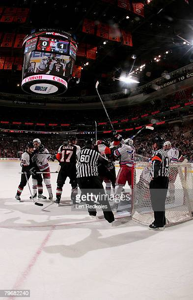 Linesman Pat Dapuzzo separates a dispute between the Philadelphia Flyers and New York Rangers at the Wachovia Center February 9 2008 in Philadelphia...