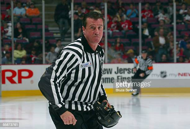 Linesman Pat Dapuzzo skates prior to start of play between the Pittsburgh Penguins and the New Jersey Devils during their NHL opening night game at...